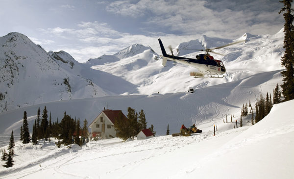 Helicopter arriving at the Sorcerer's Lodge.Golden, British Columbia, Canada.