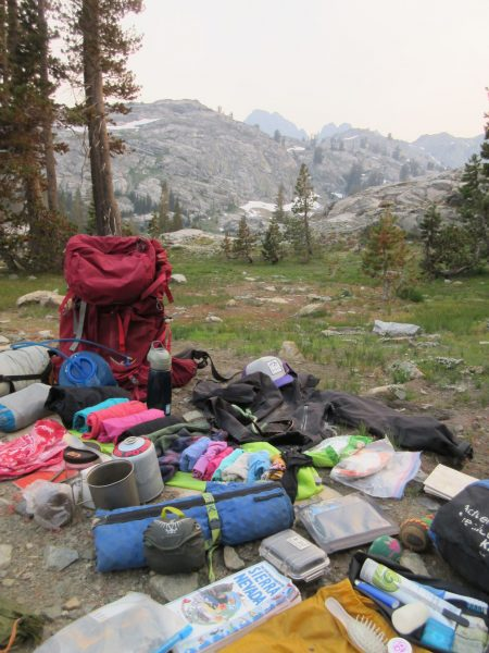 Backpacking gear packing list spread out