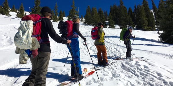 AIARE instructor Anne St Clair teaches a Backcountry Babes group about splitboarding near Mt Baldy