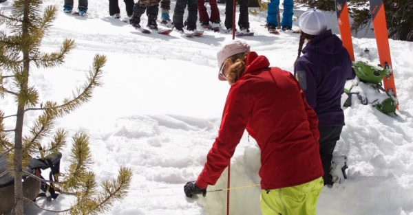 AIARE level 1 instructors Kelli Rohig demonstrates a snow profile pit on mount baldy in march with backcountry babes