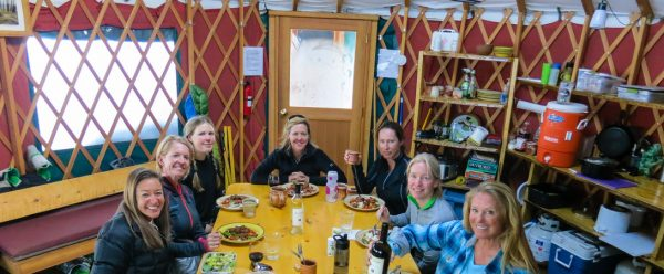 backcountry skier women dinner in the yurt