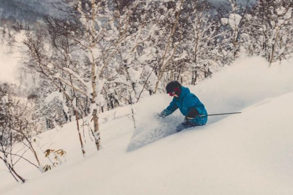 ann shreds deep powder in hokkaido backcountry skiing with guided group Backcountry Babes