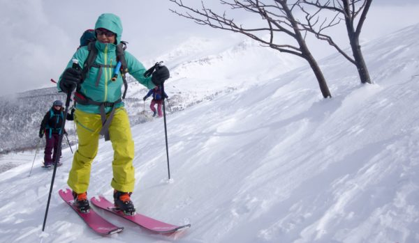 backcountry skiing hiking uphill on all women's ski trip in hokkaido japan