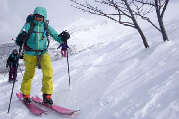 backcountry skiing hiking uphill on all women's ski trip in hokkaido japan