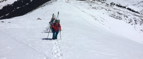 how to boot pack up steeper terrain. how to put your skis on your pack