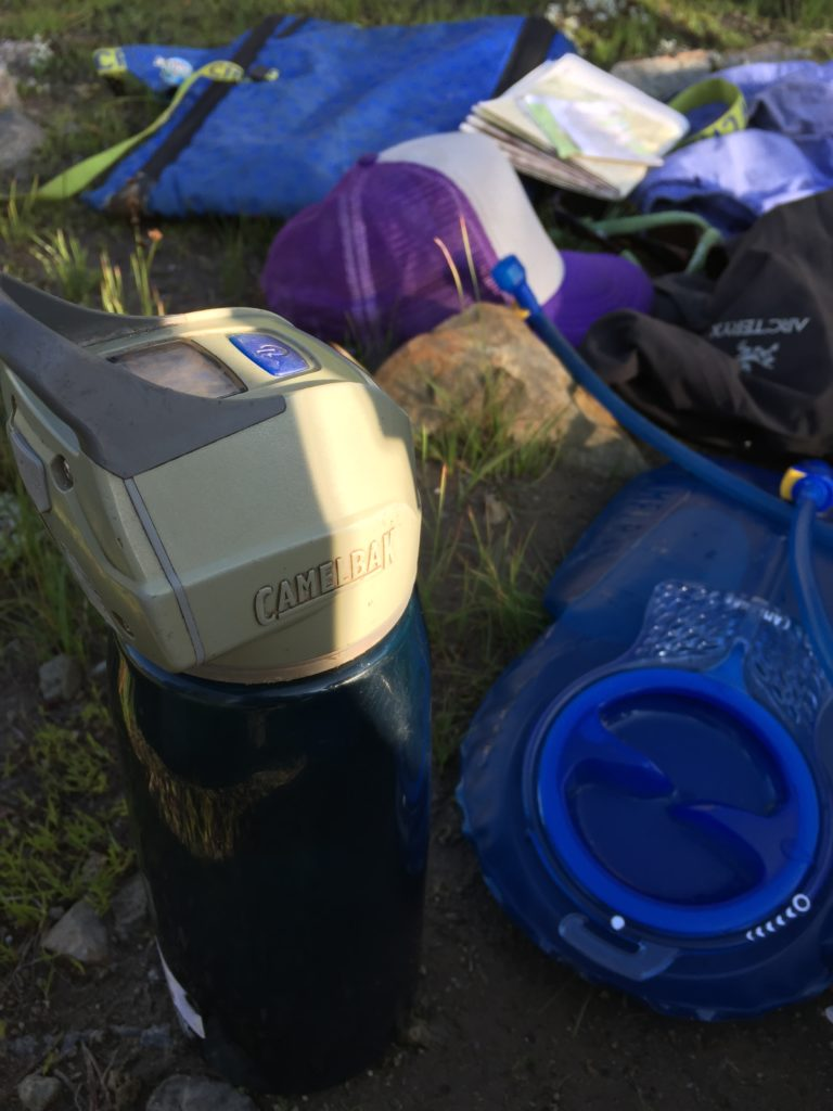Photo of the camelback lightcap on a backpacking trip for packing list