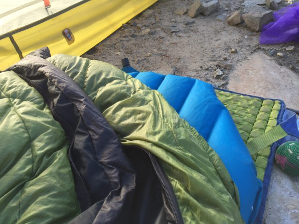 backpacking sleeping set up for our backpacking packing list. crazy creek chair, pad, sleeping bag