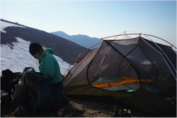 woman near a tent on shasta